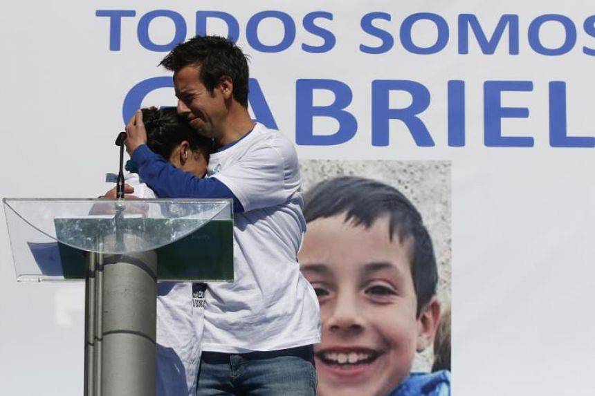 Angel Cruz and Patricia Ramirez, parents of eight-year-old Gabriel Cruz (portrait) at a rally to ask for his safe return in Almeria, southern Spain on March 8, 2018.