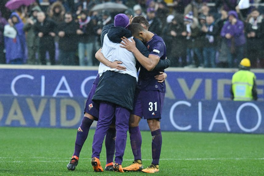Fiorentina's players comfort each other at the end of the Italian Serie A football match against Benevento at the Artemio Franchi stadium in Florence on March 11, 2018.