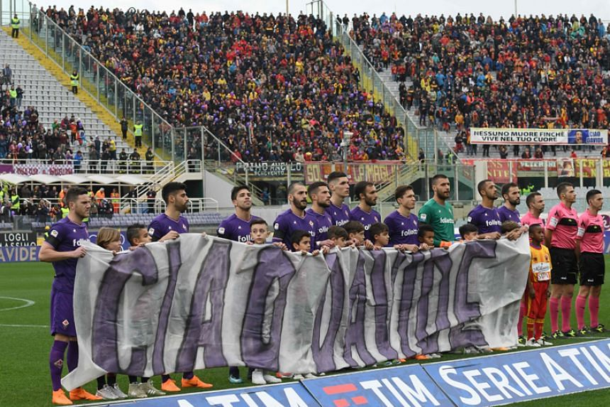 Fiorentina's players hold a banner to pay tribute to late captain Davide Astori before the match.