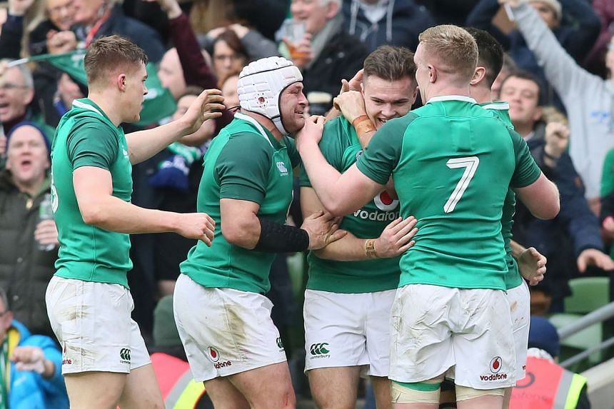 Ireland wing Jacob Stockdale (second right) celebrates with team mates after scoring his team's second try.