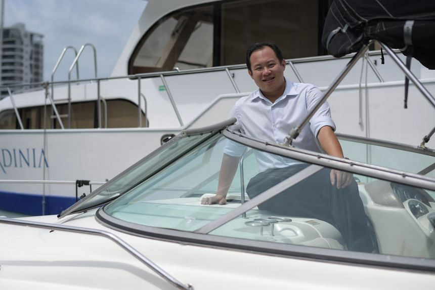 """Mr Ng Kah Meng with his yachts at One Degree 15 Marina Club in Sentosa Cove. He is a firm believer in teamwork, """"as no one can do everything or consider all angles by himself"""". That is why his yacht charter firm is called BOB Marine, with BOB standing for"""