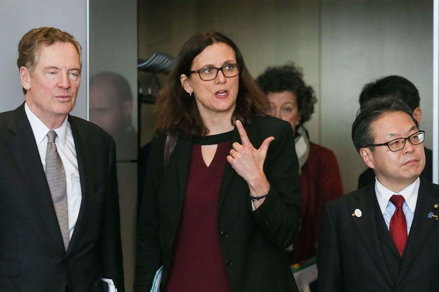 Malmstrom (centre), Lighthizer (left) and Japan's Economy Minister Hiroshige Seko arrive for tariff talks.