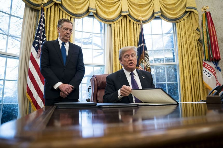 Trump signing executive orders at the White House in Washington, in January 2018.