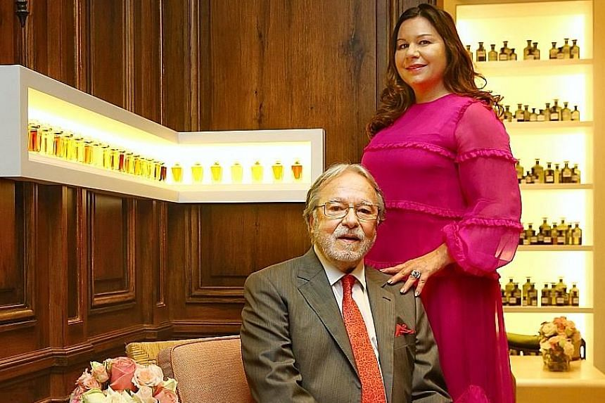 Handmade perfumes (above) by luxury label Henry Jacques, which was founded by Henry Jacques (far left). He is seen here with his daughter Anne-Lise Cremona at the brand's first standalone boutique in the world in Marina Bay Sands. Henry Jacques' arti