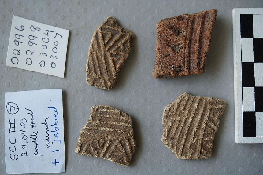 Fragments of low-fired kitchenware, featuring decorative grooves and patterns, uncovered at the Singapore Cricket Club excavation.