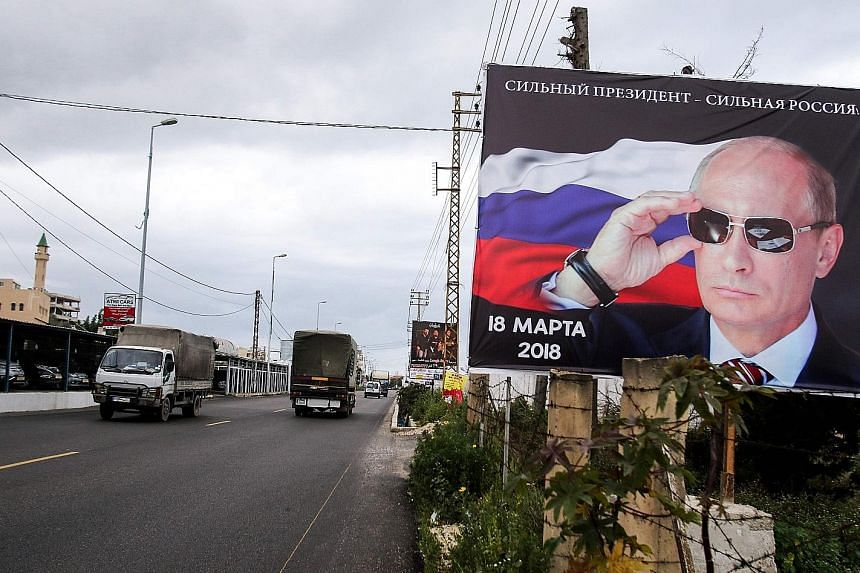 A billboard featuring Mr Vladimir Putin and the date of the Russian elections in the Lebanese city of Tyre, aimed at the Russian diaspora in the city. Mr Putin is guaranteed to be re-elected this week but his Achilles heel is the economy.