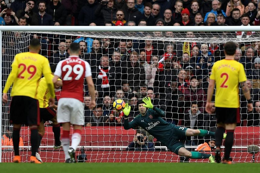 Arsenal's veteran goalkeeper Petr Cech saving Troy Deeney's penalty to keep his clean sheet and his side's two-goal lead intact. It was the Czech custodian's first spot-kick save since February 2011 for former club Chelsea.
