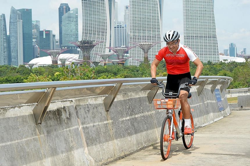 Information technology professional Wan Liu Yang on a Mobike. The latest batch of Mobikes - equipped with a three-speed gear system and adjustable seats - will be made available to participants of the OCBC Cycle from May 5-6 for free.