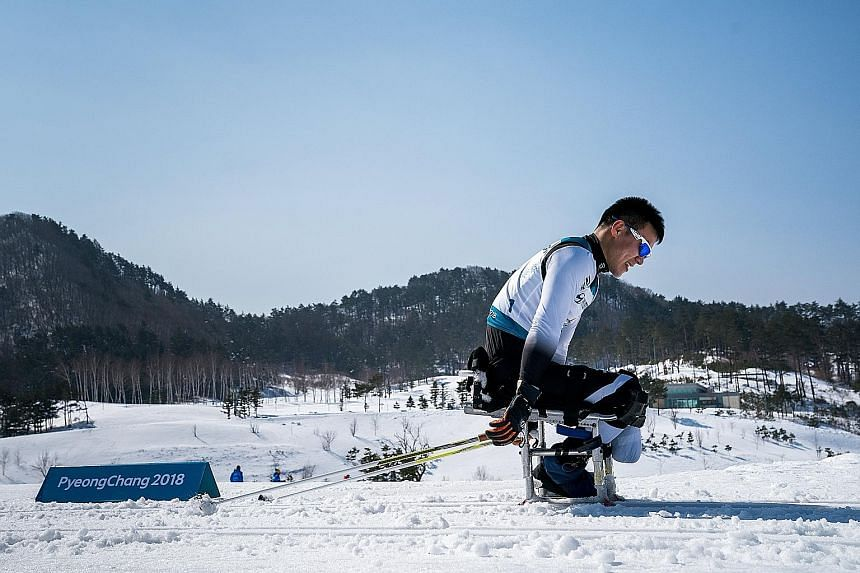 North Korean Kim Jong Hyon competing in the men's 15km sitting cross-country skiing event in Pyeongchang, South Korea. The 17-year-old and fellow rookie skier Ma Yu Chol, 27, were making their country's Winter Paralympics debut yesterday. Although th