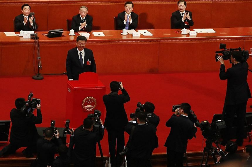 Chinese President Xi Jinping casting his vote on a proposal that included the amendment to abolish the two-term limit of the presidency, at a plenary meeting of the ongoing annual National People's Congress session in Beijing yesterday.