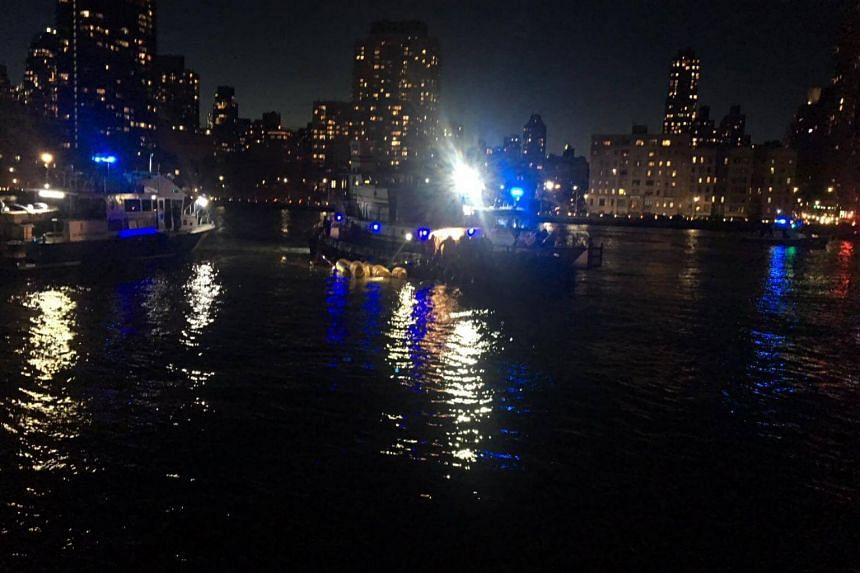 New York fire department emergency responders at the scene after a helicopter crashed in the East River, New York, on March 11, 2018.