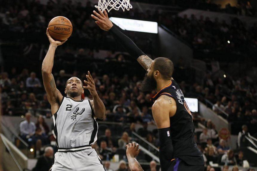 San Antonio Spurs' Kawhi Leonard shoots the ball over Phoenix Suns' Tyson Chandler during an NBA game on Jan 6, 2018.