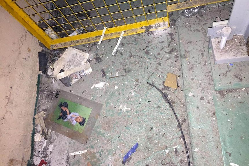 Items found in a lift pit, including a poster.
