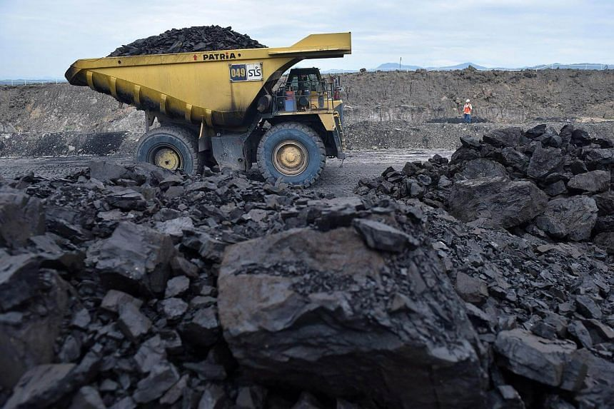 A truck carries coal at PT Adaro Indonesia coal mining in Tabalong, Kalimantan island, on Oct 17, 2017.