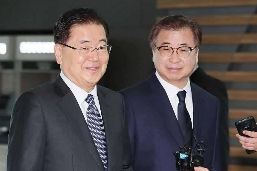 South Korea's national security advisor Chung Eui-yong (left) and spy chief Suh Hoon arrive at Incheon airport on March 8, 2018.