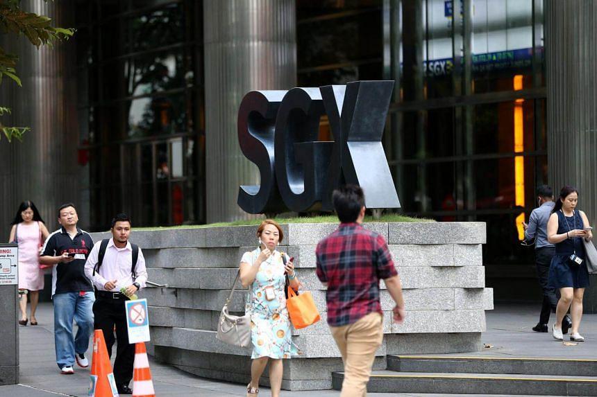 Pedestrians outside the Singapore Exchange building along Shenton Way on Feb 27, 2018.