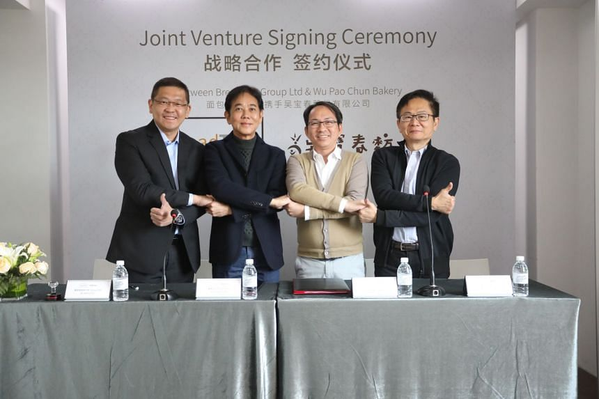 (From left) BreadTalk CEO Henry Chu, BreadTalk chairman George Quek, Wu Pao Chun Food founder Wu Pao Chun and Wu Pao Chun Food executive vice-president David Chiu at the signing ceremony.