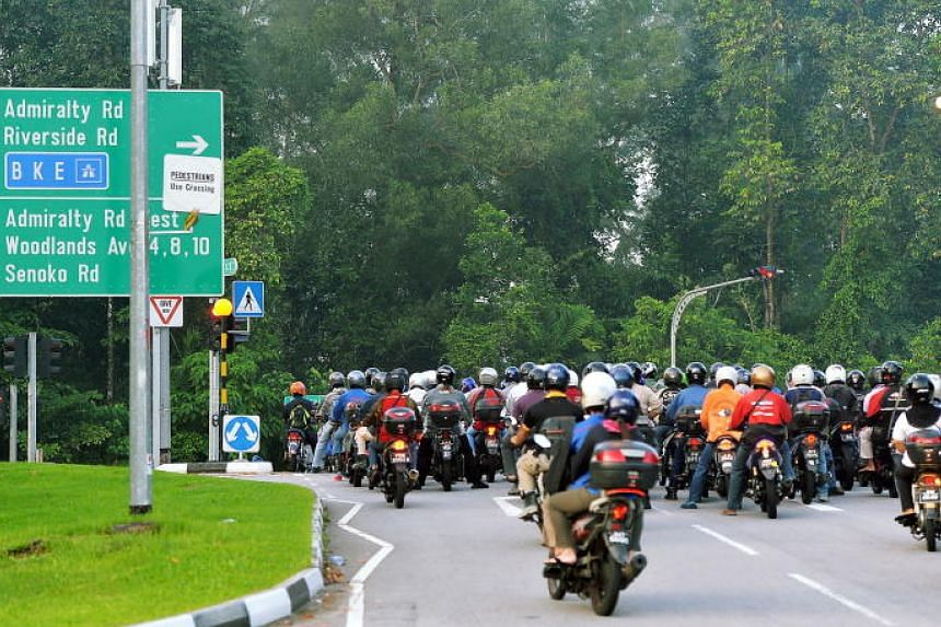 Malaysian-registered motorcycles leaving the Woodlands checkpoint.
