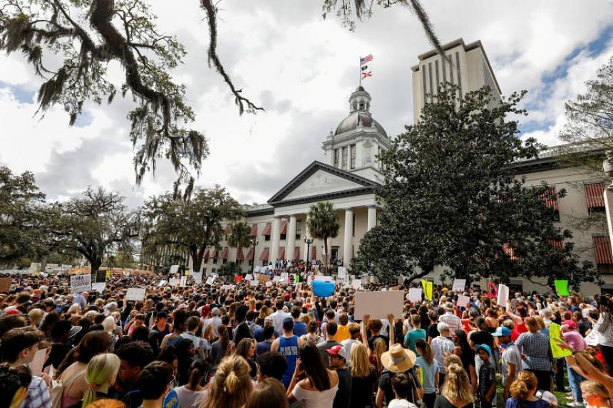 Protestors rally outside the Capitol urging Florida lawmakers to reform gun laws, in the wake of a mass shooting at Marjory Stoneman Douglas High School, in Tallahassee, Florida, US on Feb 21, 2018.