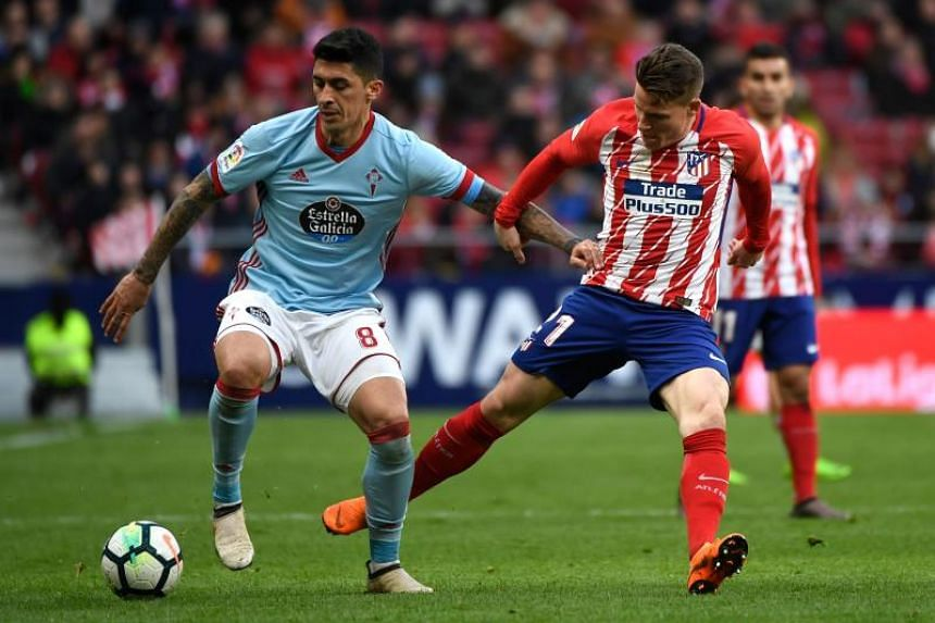 Atletico Madrid's French forward Kevin Gameiro (right) challenges Celta Vigo's Chilean midfielder Pedro Pablo Hernandez during the Spanish league football match at the Wanda Metropolitan stadium in Madrid on March 11, 2018.