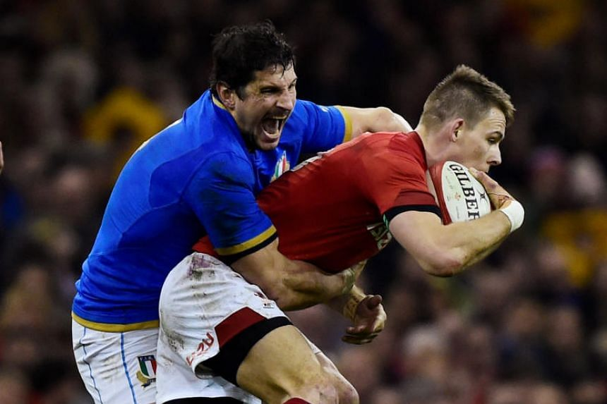 Wales' Liam Williams in action with Italy's Alessandro Zanni at the Six Nations Championship in Principality Stadium, Cardiff, Britain on March 11, 2018 .
