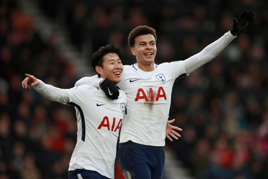 Tottenham's Son Heung Min celebrates scoring their second goal with Dele Alli at the Vitality Stadium, Bournemouth, Britain on March 11, 2018.