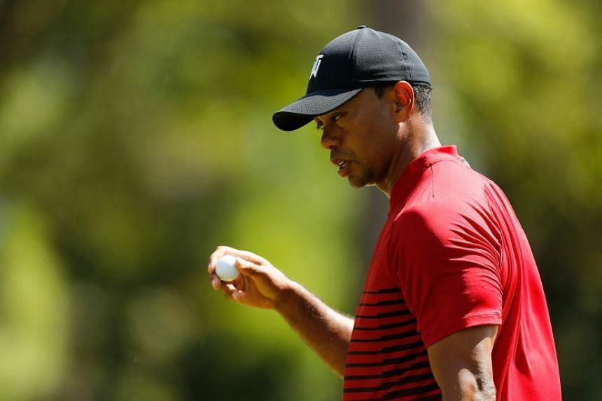 Tiger Woods reacts after a putt on the second green during the final round of the Valspar Championship at Innisbrook Resort Copperhead Course on March 11, 2018 in Palm Harbour, Florida.
