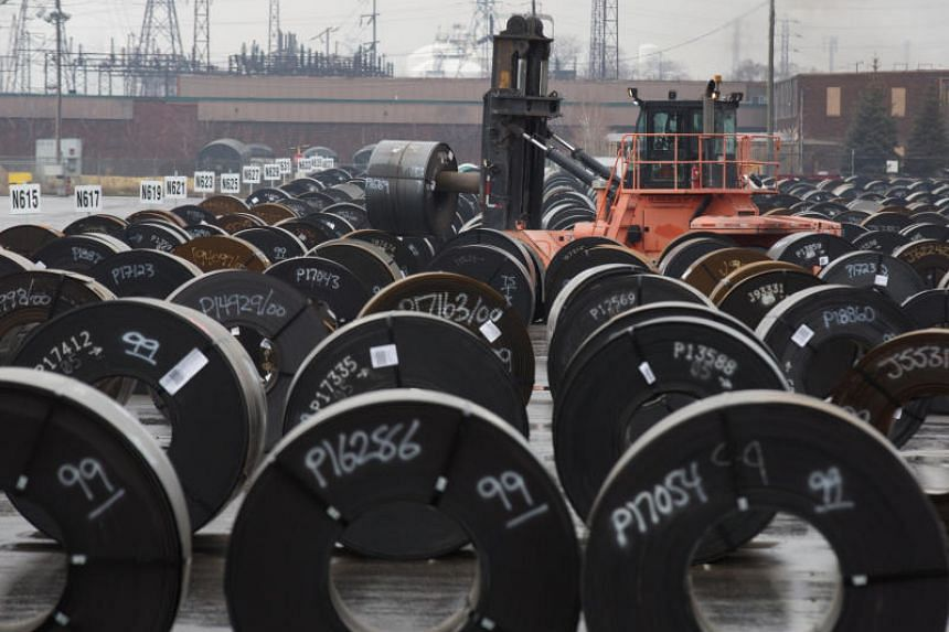 Rolls of steel are moved outside the ArcelorMittal Dofasco plant, an integrated steel producer, in Hamilton, Ontario, Canada, on March 7, 2018.