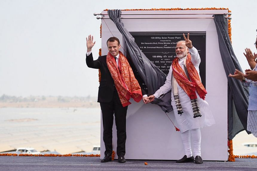 Indian Prime Minister Narendra Modi and French President Emmanuel Macron at the inauguration of a 100 MWp Solar Power Plant in Mirzapur, India, on March 12, 2018.