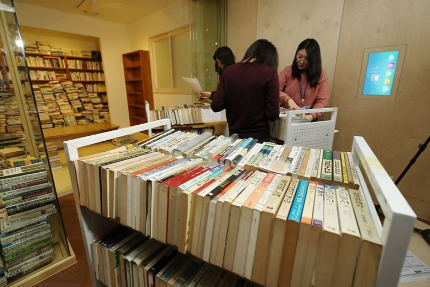 Works by poet South Korean Ko Un are removed from his exclusive exhibit section of the Seoul Metropolitan Library on March 12, 2018.