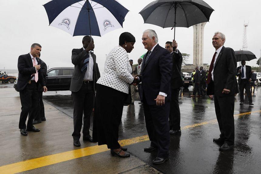 Kenya's Foreign Affairs Cabinet Secretary Monica Juma bids farewell to US Secretary of State Rex Tillerson as he boards his plane to depart Jomo Kenyatta International Airport in Nairobi on March 12, 2018.
