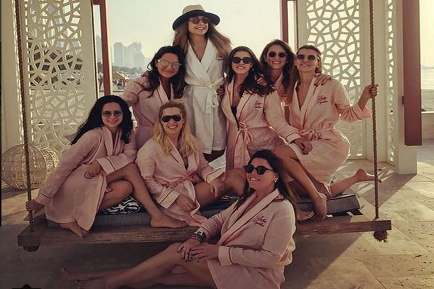 The last photo on Mina Barasan's Instagram account showed her surrounded by seven other young women, all wearing robes and sunglasses.
