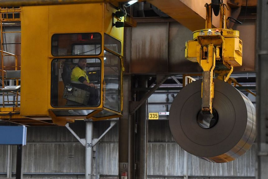 A manned crane moving steel sheet rolls at Port Kembla in Wollongong, Australia. US President Donald Trump said last Friday that he was working on a security agreement with Australia that would exempt the country from planned tariffs on steel and alu