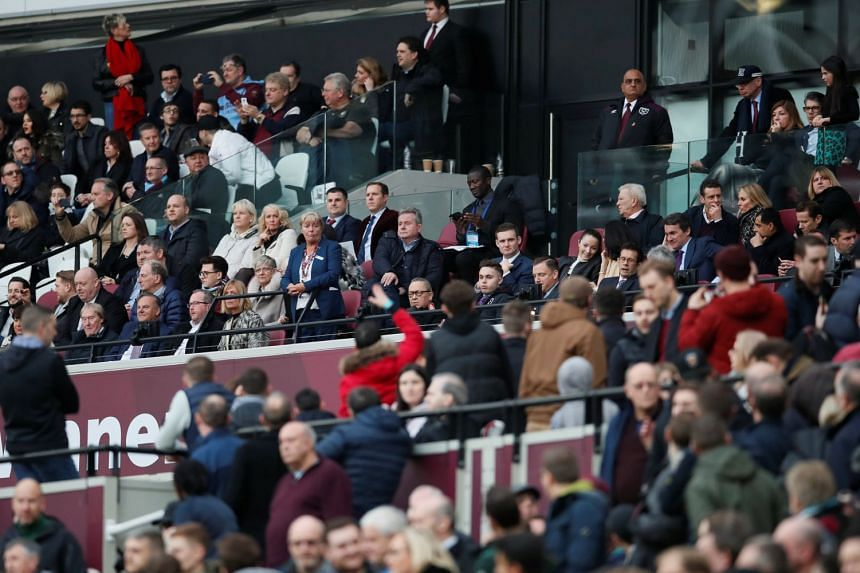 West Ham fans remonstrating with co-chairman David Sullivan and vice-chairman Karren Brady in the stands.