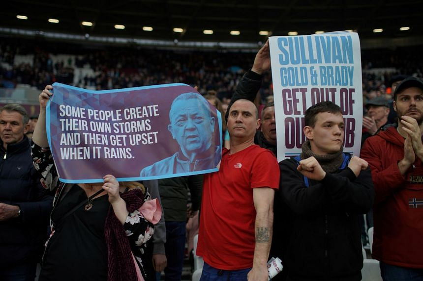 West Ham fans hold up banners protesting against the board.
