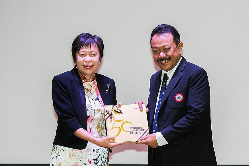 Seameo secretariat director Gatot Priowirjanto was presented with a copy of the commemorative book by Ms Susan Leong, director of the Seameo RELC Centre.