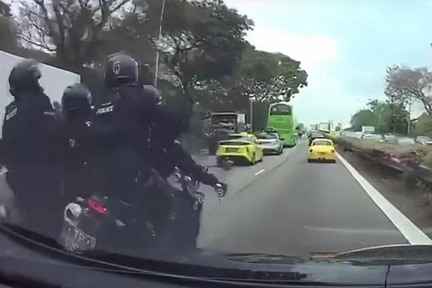 A video taken from a car's dashboard camera showing two motorcycles brushing against each other before toppling. The video ends with the police officers falling to the ground.