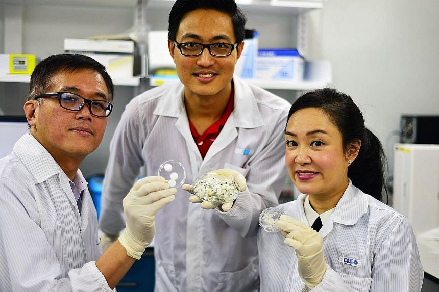 (From left) NTU's Associate Professor Andrew Tan, research fellow Wang Jun Kit and Assistant Professor Cleo Choong are part of a team that has found a way to modify collagen from fish scales to make it water soluble and potentially hold drugs to furt
