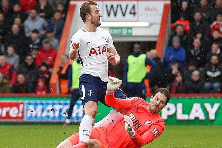 Tottenham Hotspur striker Harry Kane injured his right ankle in this tangle with Bournemouth goalkeeper Asmir Begovic during the Spurs' 4-1 Premier League win on Sunday. Kane has scored 35 goals for his club this season and, if he is forced to endure