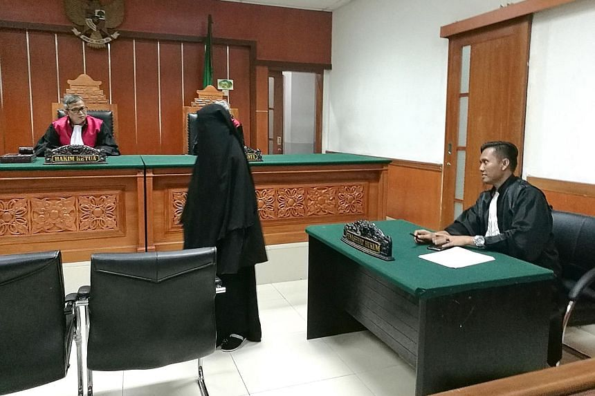 Former migrant worker Anggi Indah Kusuma appearing in a West Jakarta district court last week. She and her husband face charges related to planning terror attacks and making explosives in a rented house in Bandung.
