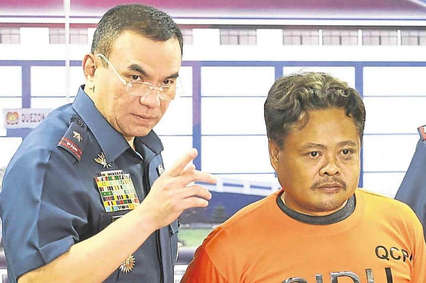 Orlando Estrera (right) with Chief Superintendent Guillermo Eleazar, director of the Quezon City Police District, during an interview with reporters on March 12, 2018.