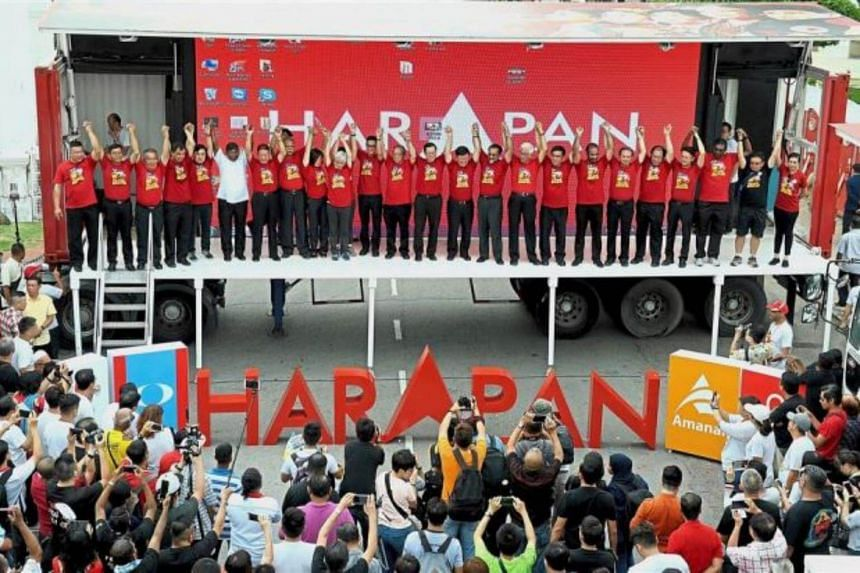 Pakatan Harapan leaders posing for photographs on a mobile stage at the Esplanade in George Town.