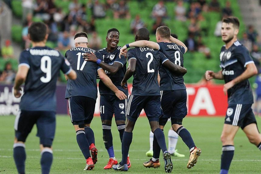 Melbourne Victory players celebrate a goal scored during their AFC Champions League Group F match against Hyundai Ulsan at AAMI Park Stadium in Australia, on Feb 13, 2018.