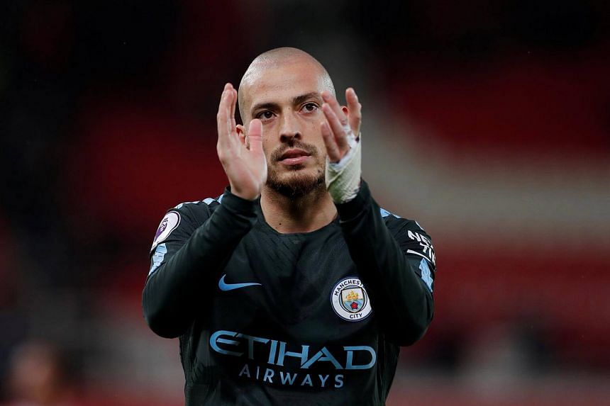 Manchester City's David Silvaapplauds fans after the match at Stoke-on-Trent, Britain on March 12, 2018.