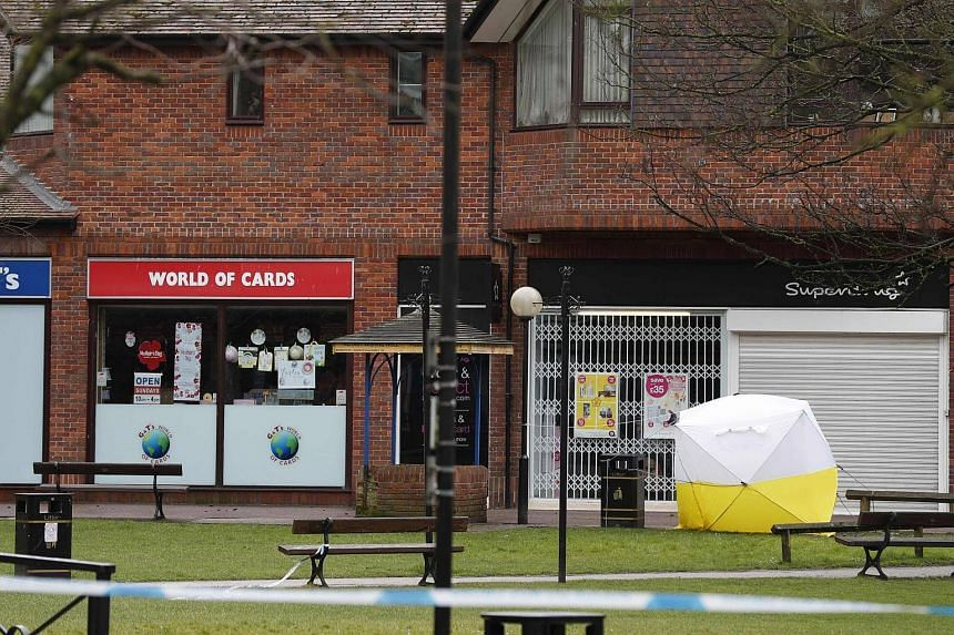 The bench, where a man and woman were found poisoned by a nerve agent, covered in a protective tent in The Maltings shopping centre in Salibury, England, on March 9, 2018.