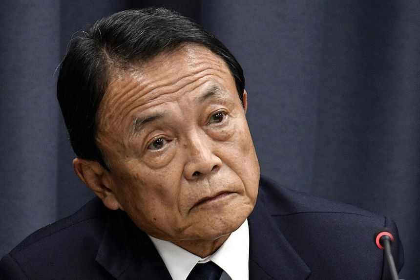 Japan's Finance Minister Taro Aso at a press conference at the Ministry of Finance in Tokyo, on March 9, 2018.