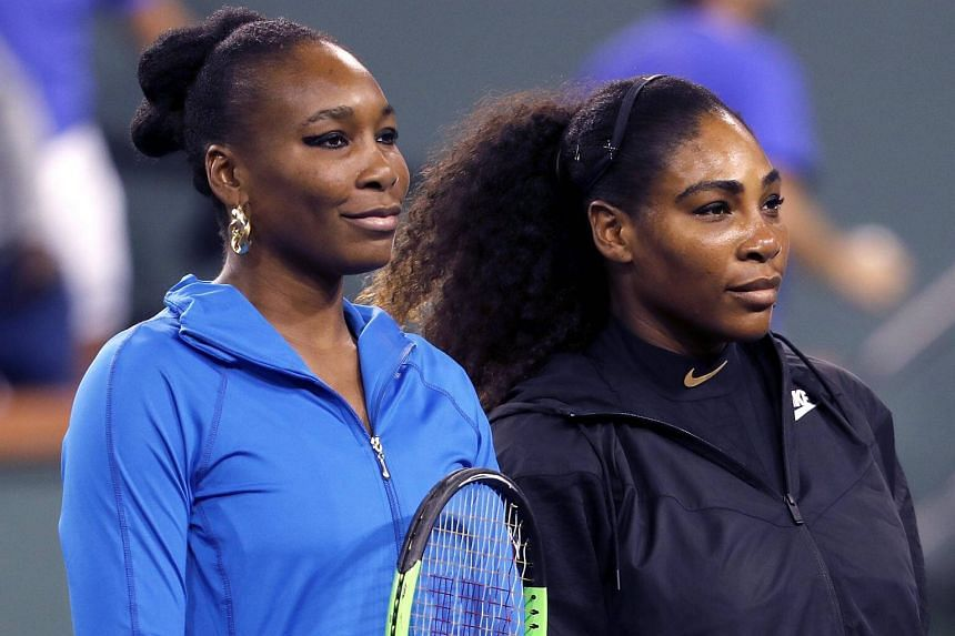 Venus Williams (left) and her sister Serena Williams before their match on March 12, 2018.