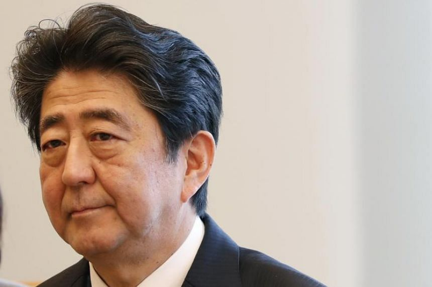 Japanese Prime Minister Shinzo Abe attends a meeting in Tokyo, on March 13, 2018.