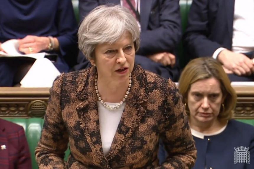 Britain's Prime Minister Theresa May delivering a statement to members of parliament in the House of Commons on the nerve agent attack against Russian double agent Sergei Skripal in Salisbury last week, in London on March 12, 2018.