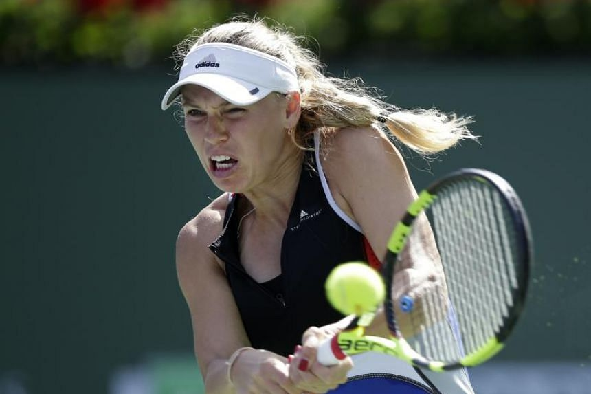Caroline Wozniacki of Denmark in action against Aliaksandra Sasnovich of Belarus during the BNP Paribas Open at the Indian Wells Tennis Garden in Indian Wells, California, USA, on March 12, 2018.